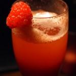 Raspberry champagne cocktail at Christmas Celebration Menu preview at Malmaison, London