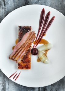 Breast of duck with a tarte fine of caramelised endive and cherry puree