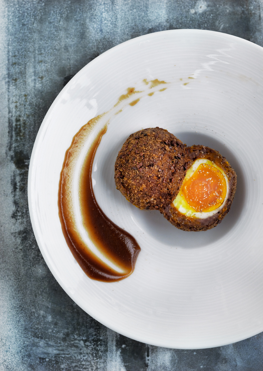 Smoked venison Scotch egg with espresso brown sauce